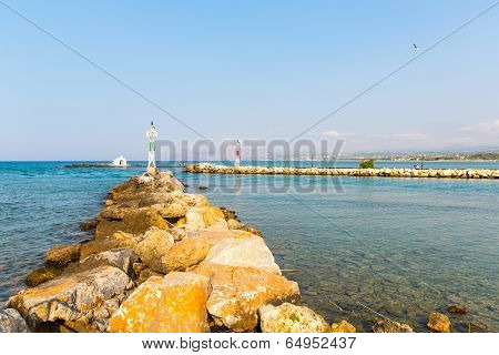 Old Venetian Lighthouse At Harbor In Crete, Greece. Small Cretan Village Kavros. Travel Background