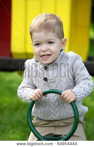 2 Years Old Baby Boy On Playground In Spring Outdoor Park