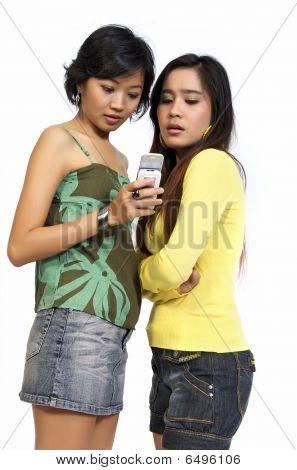 Two Girls Reading Sms