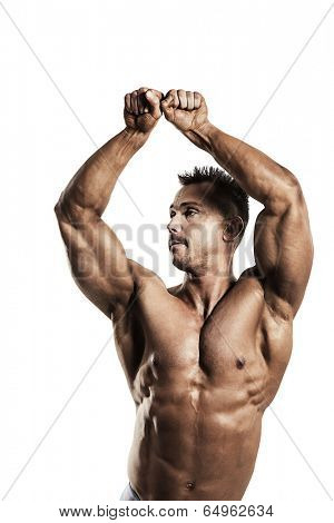 A male fit athlete posing his ripped body