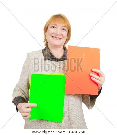 Smiling Senior Woman Holding  Red And Green Posters