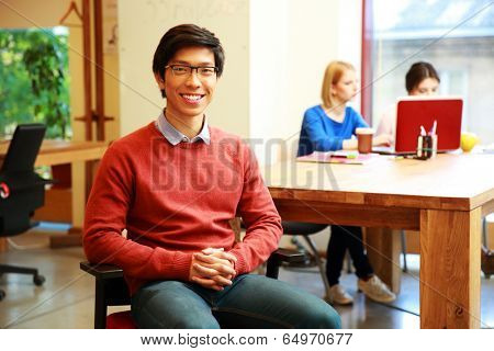 Smiling young asian student in classroom