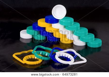multicolored stoppers and handles for PET bottle
