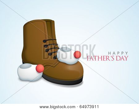 Baby booties with father leather shoe on blue background, concept for Happy Father's Day celebrations.