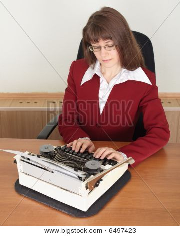 Young Woman Works With Typewriter