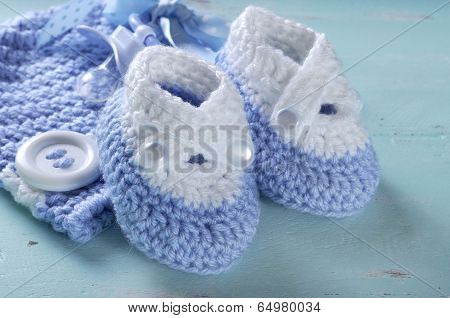 Baby Boy Nursery Blue And White Wool Booties And Bonnet Close Up