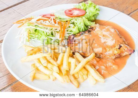 Grilled Chicken Steak With French Fries And Vegetables