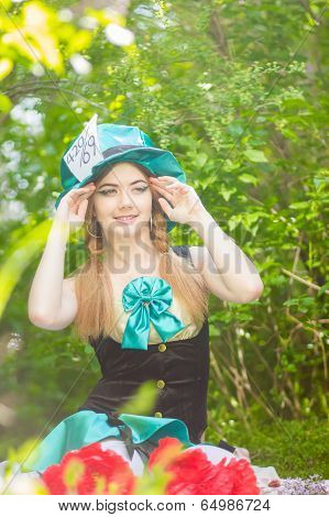 Portrait of a beautiful young woman in a costume of the Mad Hatter