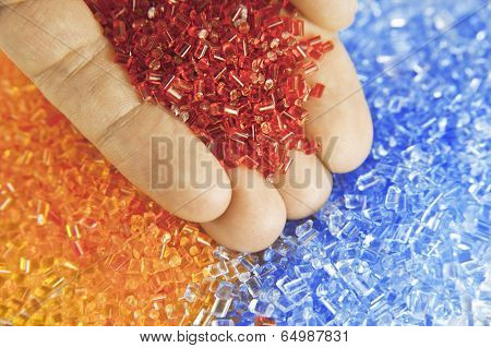 plastic polymer granule product holding in hand