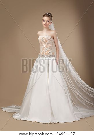Luxury. Elegant Classy Brunette In Ivory Light Dress