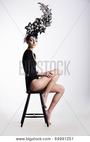 Extravagance. Glamorous Woman In Surreal Metallic Headwear
