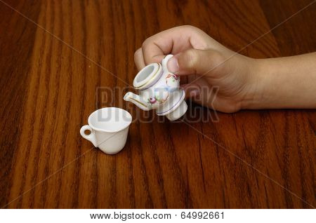 Miniature Of Tea-pot In Porcelain