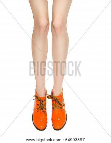 Shapely Female Legs In Orange Boots