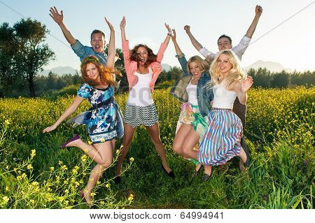 Group Of Excited Young People Leaping In The Air