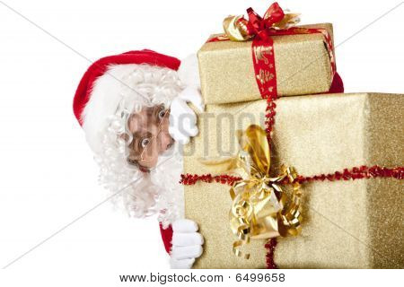 Santa Claus Is Hiding Behind Christmas Gift Boxes