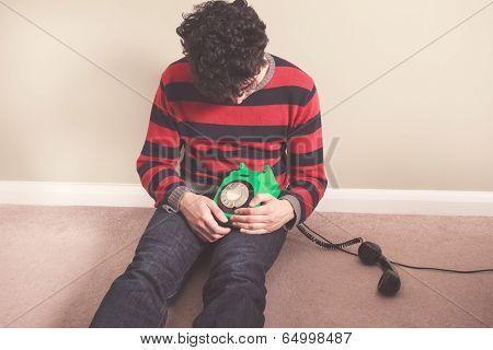 Sad Man On The Floor With Telephone