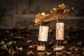 stock photo of midget  - Concept two men carry leaves wine cork figures - JPG