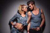 pic of hot couple  - hot young couple looking at each other and smile in studio - JPG