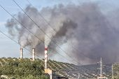 pic of gases  - Chimney expelling pollutant gases to the air Spain - JPG
