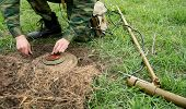 stock photo of landmines  - Minesweeper with a mine detector mine neutralizes - JPG