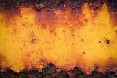 image of oxidation  - Close Up of old yellow rusty metal grunge background - JPG