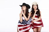 stock photo of fancy-dress  - Fanciful Joyful Women Cowgirls and American Flag - JPG