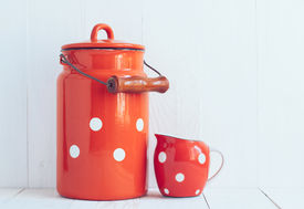 foto of milkman  - Set of vintage utensils milk can and small polka dots milkman home kitchen decor in country style painted white background  - JPG
