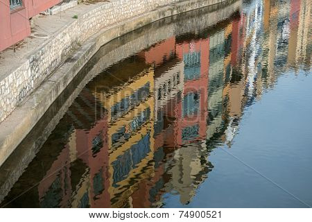 Reflection Of Colorful Houses In Onyar River In Girona, Spain.