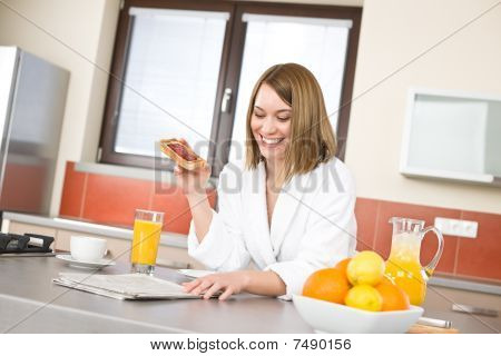 Breakfast - Smiling Woman With Orange Juice In Kitchen