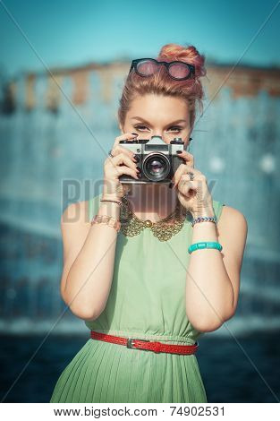 Beautiful Girl In Vintage Clothing Making Picture With Retro Camera