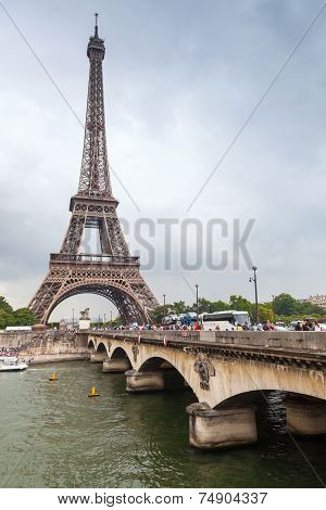 Eiffel Tower And Old Bridge Over Seine River