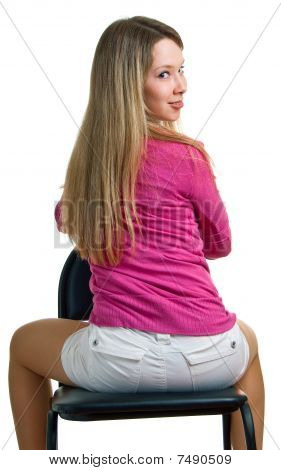 Smiling Girl Sits On A Chair