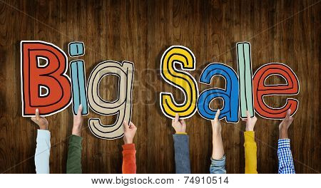Group of Hands Holding Word Big Sale