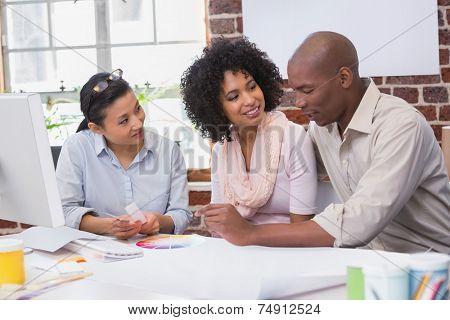 Interior designer speaking with clients in office