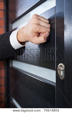 Salesman Knocking On The Door