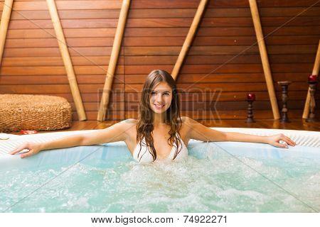Beautiful woman relaxing in a whirlpool
