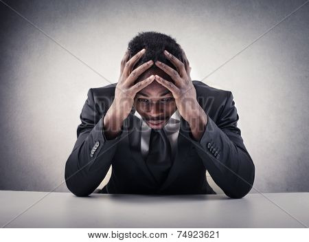 Desperate businessman thinking of a possible solution