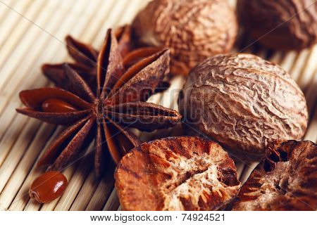 Stars anise with nutmeg on wicker background
