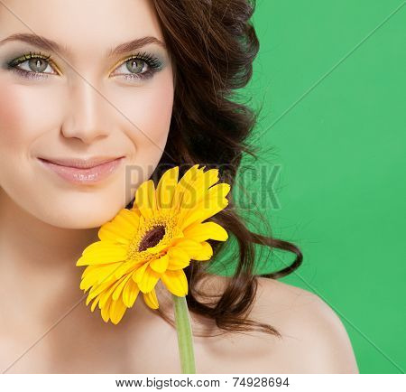 closeup portrait of attractive  caucasian smiling woman brunette isolated on white studio shot lips  face hair head and shoulders skin yellow flower makeup