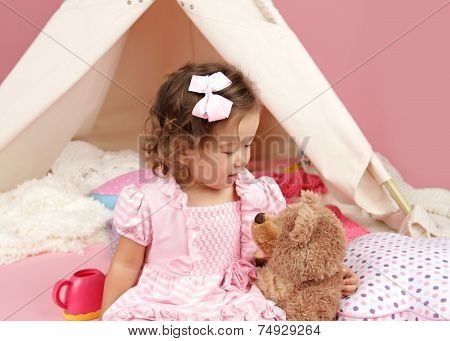 Happy Toddler Girl Playing With Stuffed Bear Toy