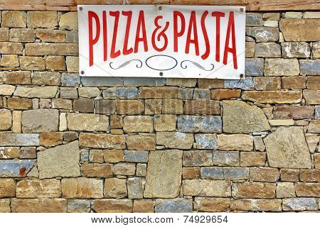 Italian Food Sign On Old Stone Wall