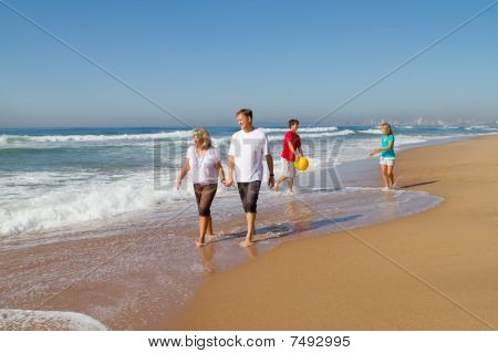 familiy playing on beach