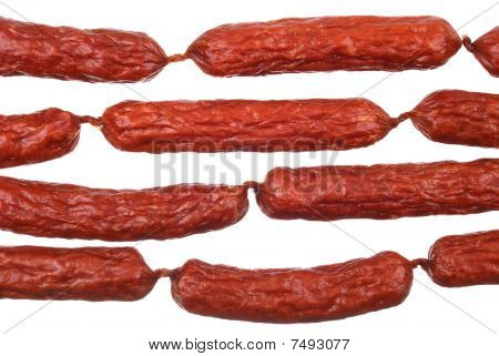 Background Of Tasty Sausages On White