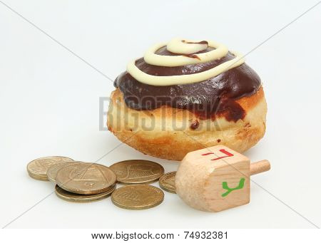Hanukkah doughnut and spinning top - Traditional jewish holiday food and toy.