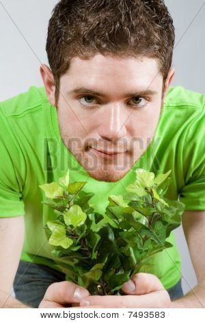 Man Holding Small Plant