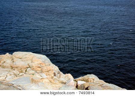 Rocky Coast with Dark Blue Ocean Water