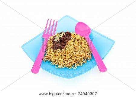 Eating Noodles With Fork And Spoon On White Background
