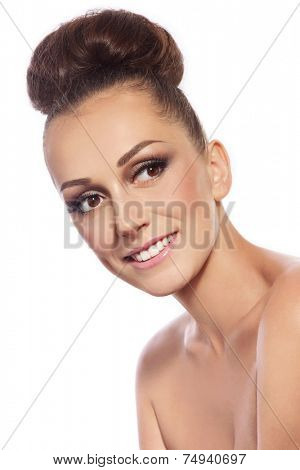 Young slim attractive smiling woman with stylish hair bun over white background