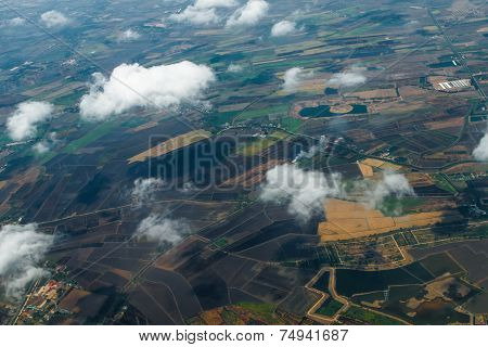 Aerial View Of Clouds And Village
