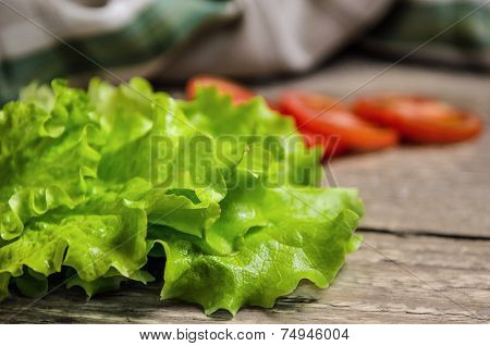 Fresh Green Salad And Tomatoes On Table